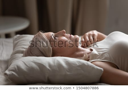 A tired-looking woman Stock photo © photography33