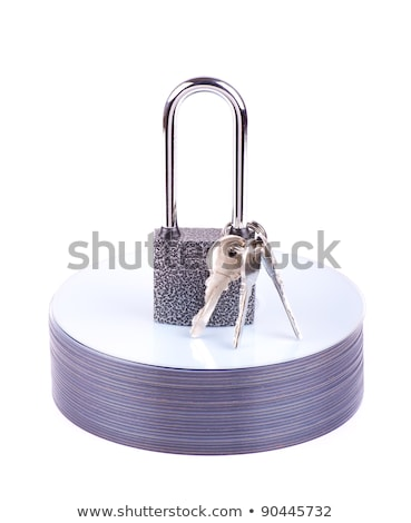 Padlock and key on the stack of CD  Stock photo © a2bb5s