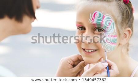 Little girl cara pintado artista festival mão Foto stock © Kuzeytac