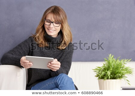 Happy Mature woman sitting on wall Stock photo © roboriginal