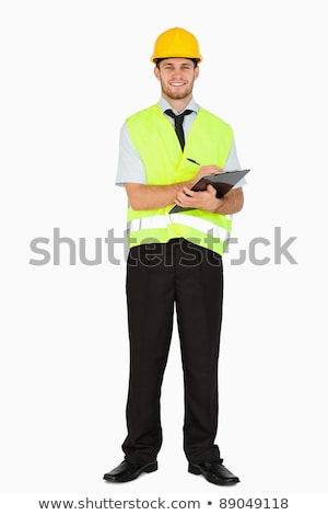 Young foreman taking notes on his clipboard against a white background Stock photo © wavebreak_media