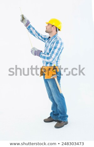 protective gloves and a hammer against a white background stock photo © wavebreak_media