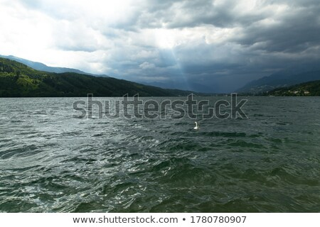 Dağ manzara sahil sağanak gökyüzü imzalamak Stok fotoğraf © kawing921