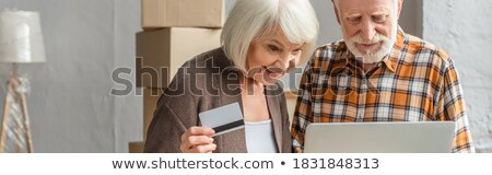 senior · uomo · maturo · home · shopping · carta · di · credito · laptop - foto d'archivio © luminastock