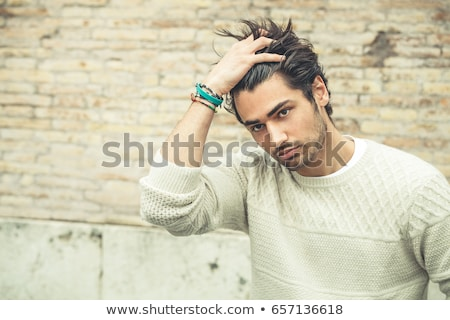 casual man outdoor with hand passing through hair stock photo © feedough