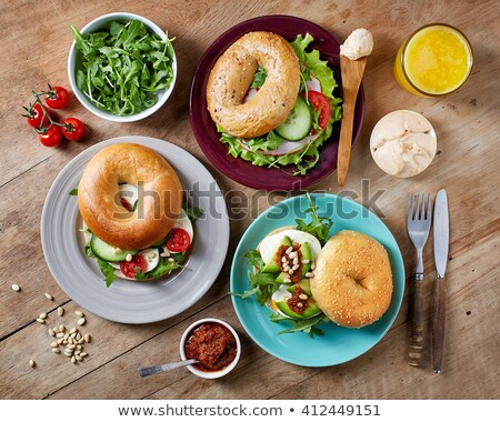 Bagel with ham, cheese and lettuce and orange juice Stock photo © aladin66
