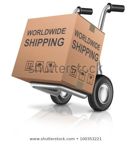 Világszerte szállítás kartondoboz kéz teherautó jelmondat Stock fotó © tashatuvango