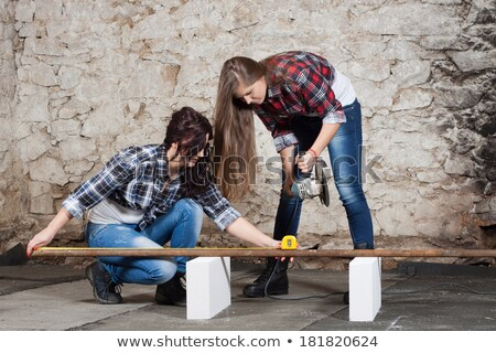 Two young long-haired woman with a drill Stock photo © maros_b