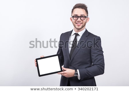 Stock photo: business man presents his tablet