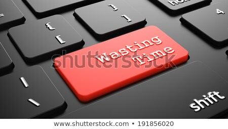 Wasting Time on Red Keyboard Button. Stock photo © tashatuvango