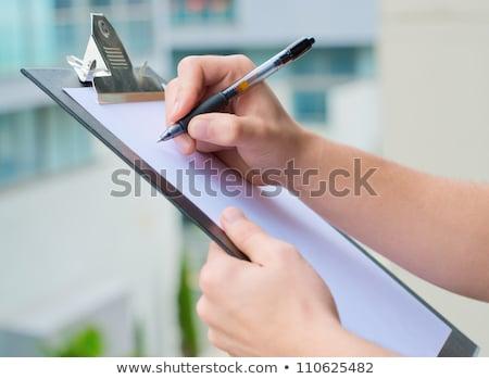 biznesmen · zauważa · schowek · kopia · przestrzeń · odizolowany - zdjęcia stock © dgilder