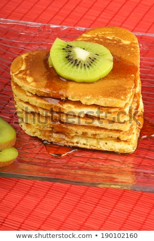 Stack of heart-shaped pancakes with syrup and kiwi fruit Stock photo © aladin66