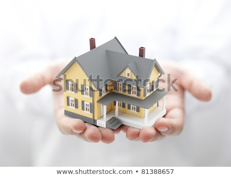man holding model house in palm of hand stock photo © highwaystarz