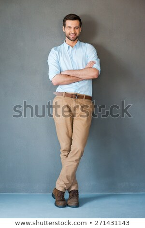 fashion man relaxing while looking at the camera stock photo © feedough