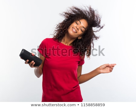 Brunette with portable music device Stock photo © photography33
