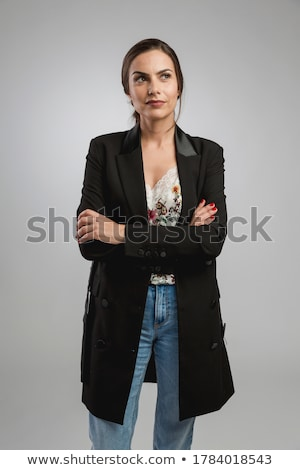 Portrait of a beautiful young businesswoman with arms crossed Stock photo © wavebreak_media