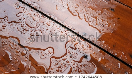 Stock photo: Wet wooden plank texture