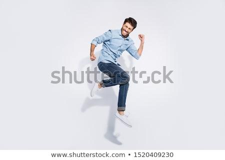 Alto volare uomo jumping denim moda Foto d'archivio © lunamarina
