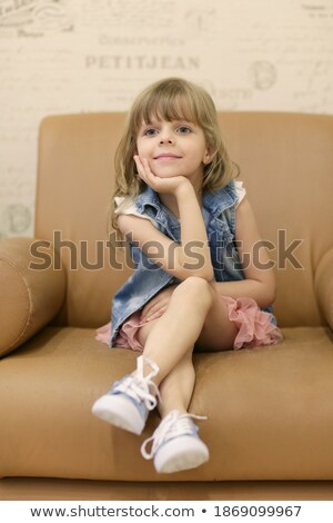Portrait of girl sitting in armchair. Interior in retro style. Looking aside. Vertical format. Stock photo © Paha_L
