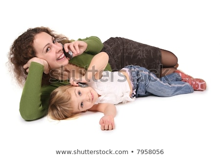 mother and daughter lie they talk on the cell phones on the the white Stock photo © Paha_L