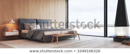 Modern bedroom with a fireplace Stock photo © jrstock