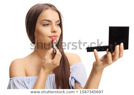 Mulher atraente olhando espelho batom vermelho atraente Foto stock © deandrobot