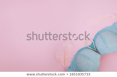 Laying beauty with pink brassiere stock photo © Novic