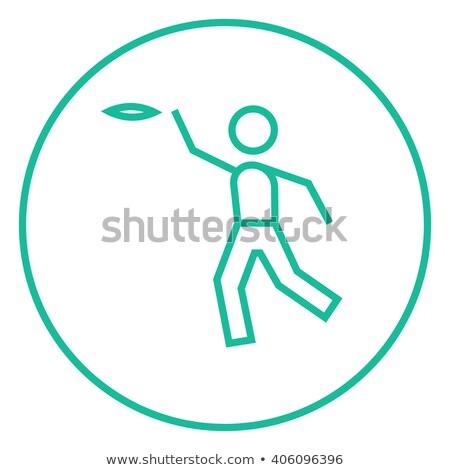 Man playing with flying disc line icon. Stock photo © RAStudio