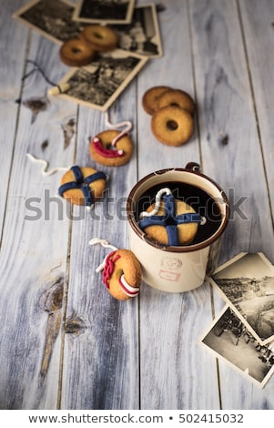 cookies decorated like lifebuoys by the ship, one floats in a cup. Copy space stock photo © faustalavagna