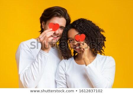 Eyes to eyes interracial couple Stock photo © deandrobot
