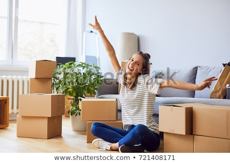 Attractive young woman moving house Stock photo © dash
