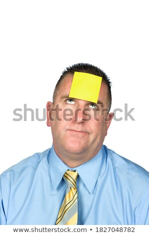 Businessman with sticky note stuck on his forehead Stock photo © wavebreak_media