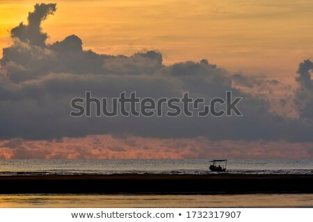 Grupo pier pôr do sol nuvens peixe sol Foto stock © joyr