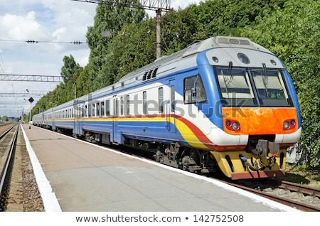 Suburbano eléctrica tren moderna puente cielo Foto stock © reticent