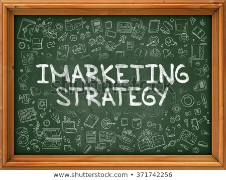 Hand Drawn Imarketing Strategy on Green Chalkboard. Stock photo © tashatuvango