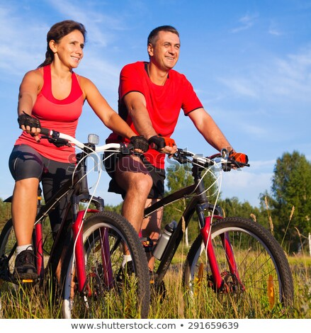 Portrait of male and female cyclist Stock photo © IS2