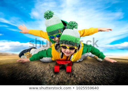 Two kids on a skateboard Stock photo © IS2