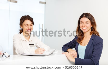Woman standing in front of desk Stock photo © IS2