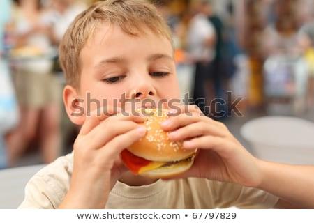 мало кавказский мальчика еды гамбургер аппетит Сток-фото © RAStudio