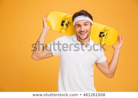 молодые счастливым скейтбордист человека скейтборде Сток-фото © deandrobot