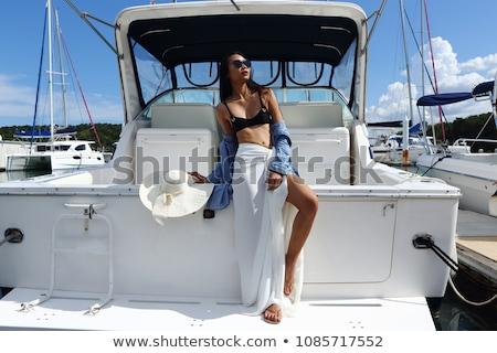 Kobieta dok jezioro wolności wakacje Zdjęcia stock © IS2