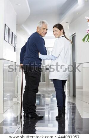 Pielęgniarki młoda dziewczyna spaceru korytarz kobieta zdrowia Zdjęcia stock © IS2