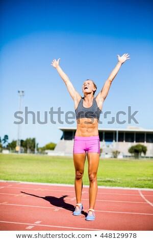 женщины спортсмена позируют победу белый женщину Сток-фото © wavebreak_media