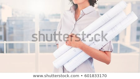 Architect carrying blueprint in office Stock photo © IS2