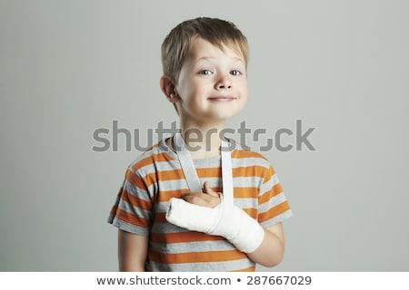 Fiú tapasz kéz aranyos kaukázusi gyermekkor Stock fotó © IS2