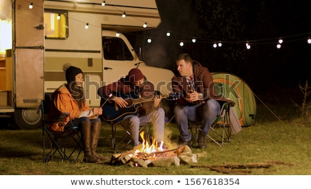 Friends in field by camper van Stock photo © IS2