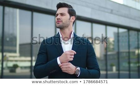 portret · knap · zakenman · wijzend · iets · witte - stockfoto © svetography