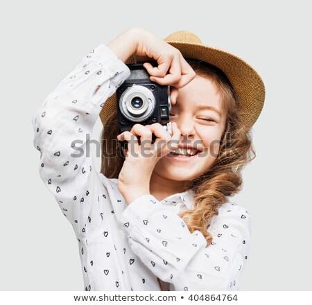 portrait of a cute little girl taking a photo stock photo © konradbak
