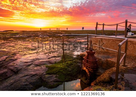 Sunrise and fisherman at Mona Vale Australia Stock photo © lovleah