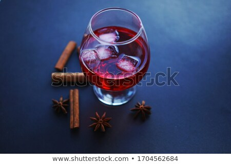 Goblet of hot aromatic mulled wine with spice. Stock photo © brulove